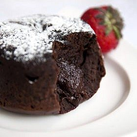 Delicious chocolate fondant with syrop close-up