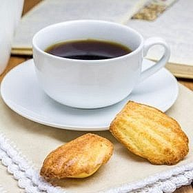Homemade madeleines with a cup of coffee